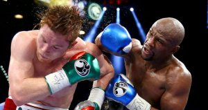 Mayweather remains undefeated, whips Alvarez