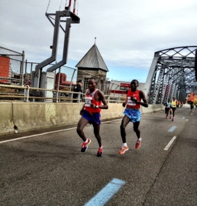 Crossing Madison Avenue Bridge from Bronx into Manhattan Mutai begins his final assault. Only Biwott can answer