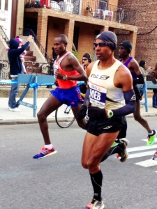 Meb showing early form on Fourth Ave. in Brooklyn dead into the 15 mph wind