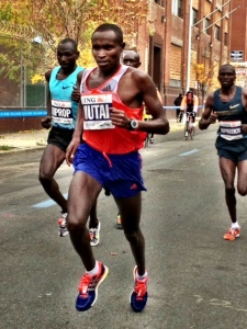 Mutai begins to make his presence felt, 35K in 1:46:42.. Last 5K in 14:58, fastest of the day