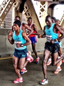 London Marathon champion Tsegay Kebede leads over Queensborough Bridge, 25K 1:16:59 (15:18 last 5K)