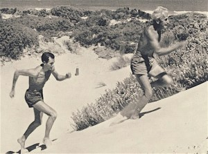 Percy Cerutty leads Herb Elliott up the sand dunes of Port Sea