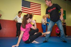 Todd with assistant Lindsey Collins demonstrating RunSafer ground technique