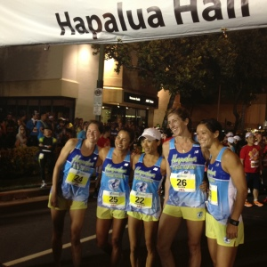 First group of Team Hawaii about to start along Waikiki Beach, including winner Eri MacDonald on far left