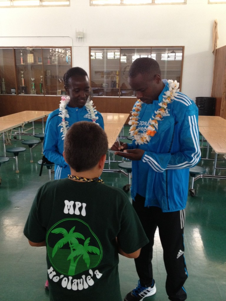 Champions Isabella Ochichi & Patrick Makau sign autographs at Mid-Pacific Institute