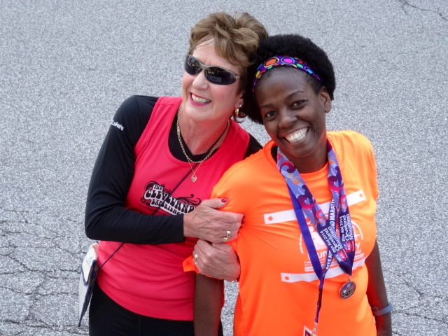 Annde Audain with We Run the City program founder Tara Taylor all smiles as over 700 kids complete the program in 2014