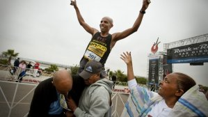 Meb lifted by dad Russom after winning 2012 RnR Half