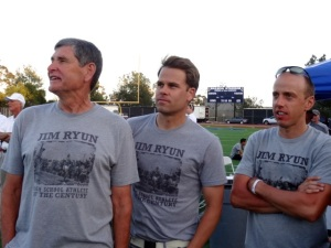 Jim Ryun in rapt attention with co-meet director Josh Cox, and American mile record holder Alan Webb