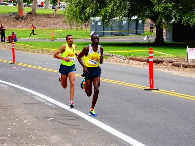 Kenya's Geoffrey Bundi trying to break Ethiopia's Solomon Dekissa at base of final hill