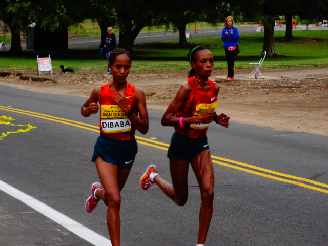 "Ethiopia's Birhane Dibaba takes the measure of 3X Boston Marathon champion Rita Jeptoo of Kenya - 69""34 -- 69:37"