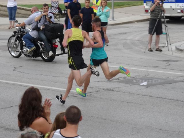 Christo Landry (l) & Sean Quigley (r) battle down Brady Street in final mile