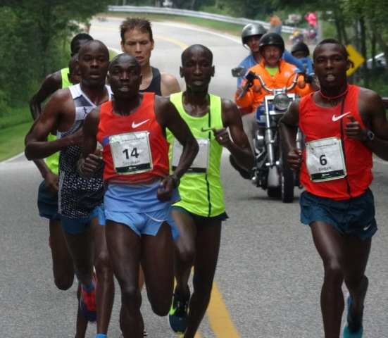 Two year 4th placer Stephen Kibet, #14, moves into front row.