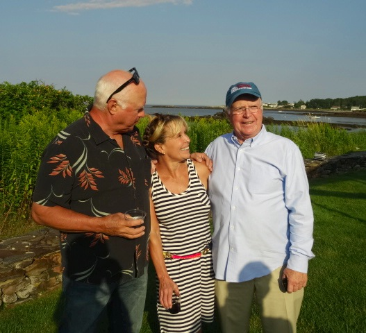 Bob Barnaby (left) with hostess Candace Karu and Paul Daley