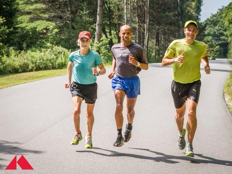 There is no finish line:  Joanie with fellow Olympic medalist and Boston Marathon champion Meb Keflezighi and ex-B2B 10K president Dave Weatherbie (David's dad Keith was Joanie's high school coach in Cape Elizabeth, Maine)