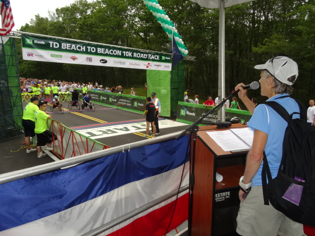 Race Founder Joan Benoit Samuelson addresses the field.