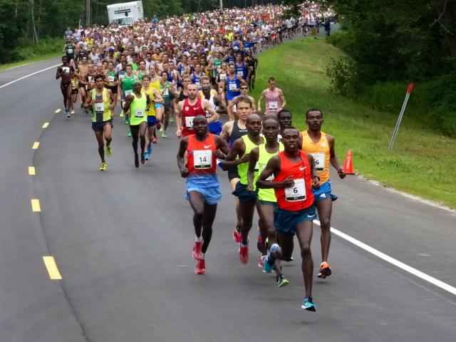 Kenya's Bedan Karoki leads them out, 4:20 first mile.