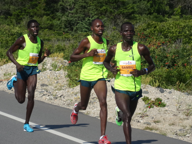 3 miles in 14:39 (4:33) with Sambu finding his rhythm of the flat stretch of Surf Drive.  Kogo and Bett suffering.