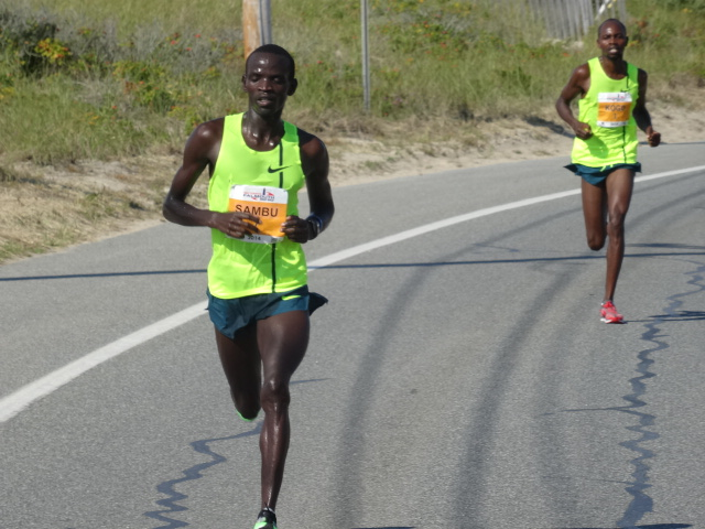 Sambu dispatches two-time Falmouth champ Kogo (2007 & 2013) with a 4:28 4th mile (18:17)