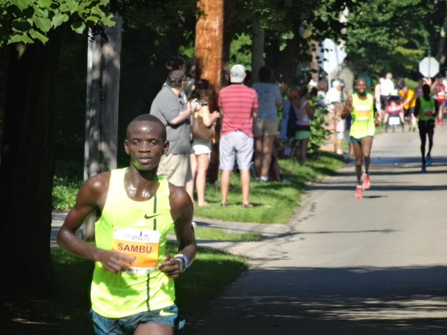 Sambu almost placid as he nails a 4:24 5th mile heading off the water (22:41), each mile faster than the previous one.