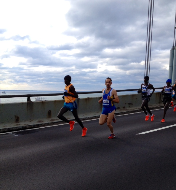 Peter Kirui leads off the Verrazano Narrows Bridge