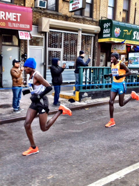 two-time defender Geoffrey Mutai up 4th Ave. in Brooklyn with Peter Kirui doing his Michael Jordan tongue wag in 2nd.