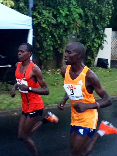 Deep in the well, Chebet (#3) and Lonyangata (#6) battle for the win and the $40,000 first place prize. 24th mile fell in 4:44!