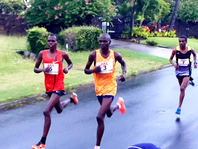 The action in Honolulu, as per usual, came as the course came off the highway and entered the Kahala neighborhood after 35K. Here #6 Paul Lonyangatta of Kenya, a 2:07:44 man with two sub-60 half-marathons to his credit, surged hard to break up the pack. Only countryman Wilson Chebet, the three-time Amsterdam Marathon champion, and Ethiopia's Geb Abraha, fourth here last year, could answer.