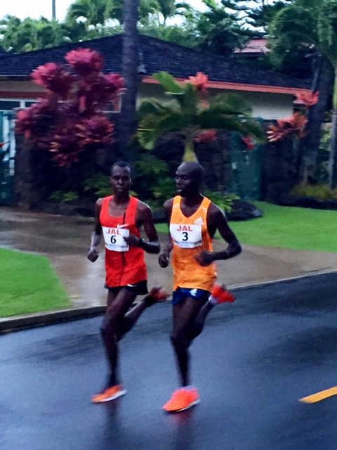 Lonyangata and Chebet drive away from Abraha by 23 miles. 9:59 from 21 - 23.
