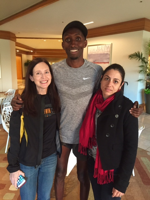 Abdi with Jupiter, Florida fans Gwynne Searly (left) and Karina Dulin