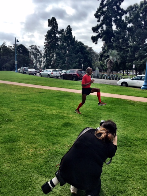 Photog Emily Maye taking aim at Meb doing post-run drills