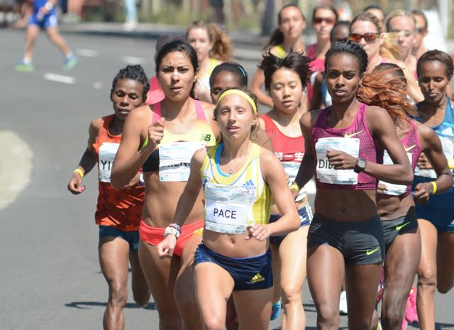Pacesetter Emily Lipari leads Genzebe Dibaba (right) and Brenda Martinez in opening mile.