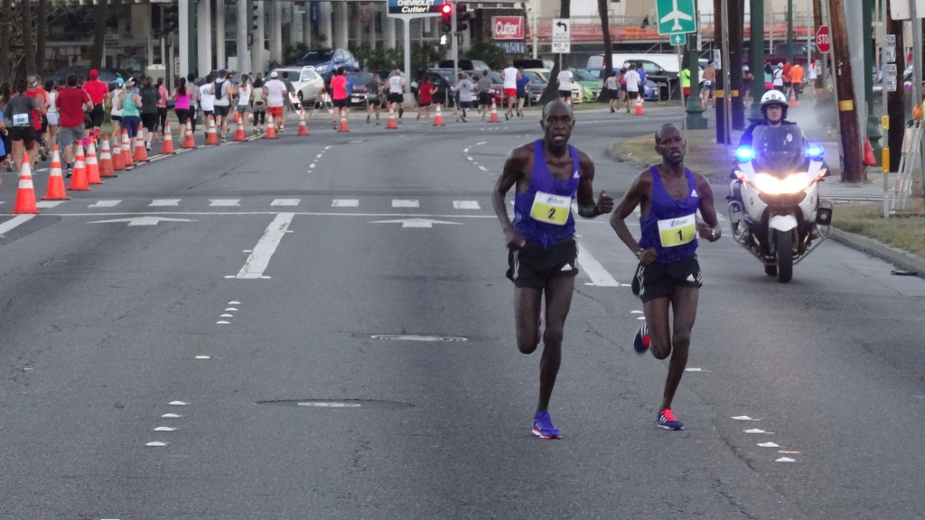 Peter Kirui (#2) and Nicholas Kemboi along Ala Moana Blvd.