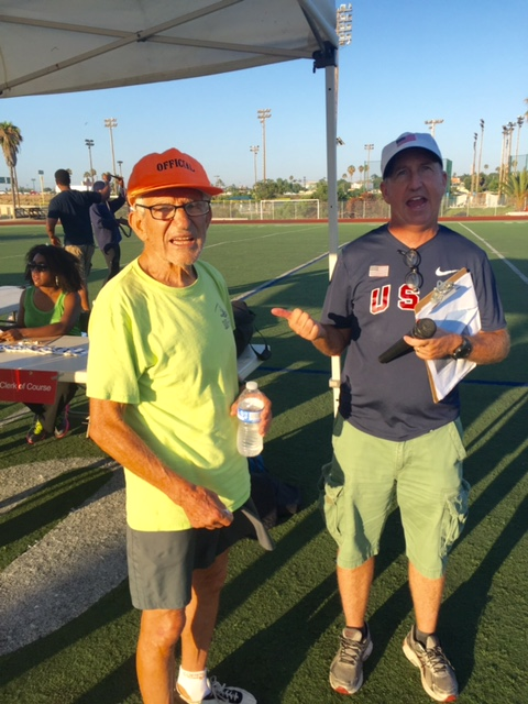 Paul Greer welcomes 84 year-pld Charles Kachadoorian, retired Air Force Master Sargeant as the men's mile is called.