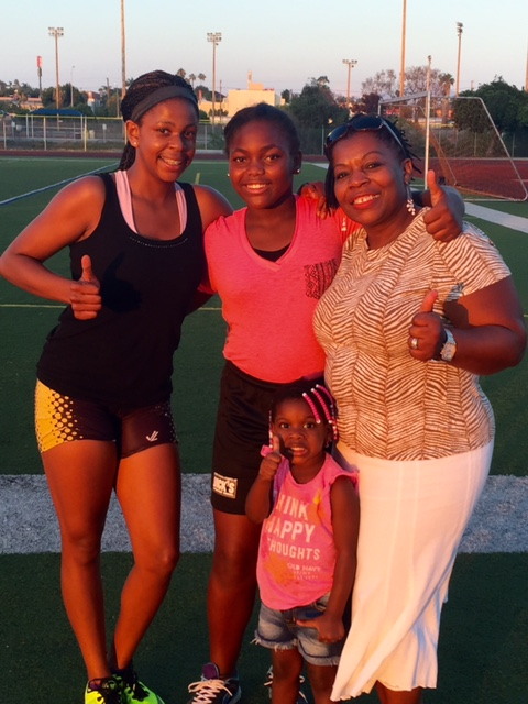 The Gray family: 13 year-old Tashi runs for the San Diego Cheetas, 12 year-old Ramisi won the women's shot put at 23' 5