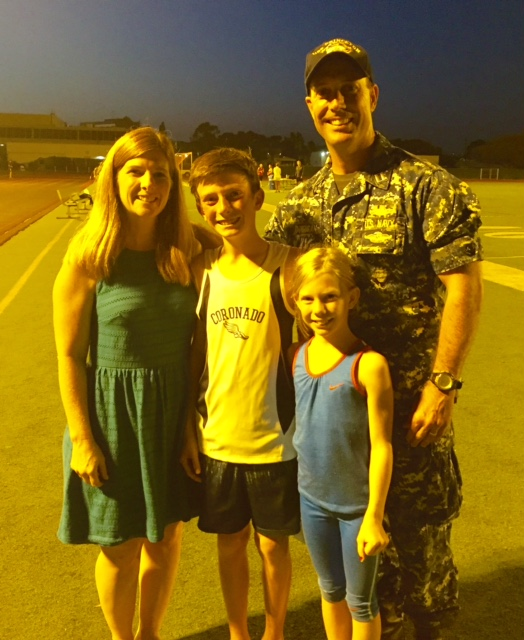 The Corrigan Crew: Mom Tiffany, 13 year-old Ethan, who took 4th in the mile 5:35.37, then won the 2-mile in 12:11.07); 10 year-old Jenna won the girl's 220; and dad Lt. William Corrigan.