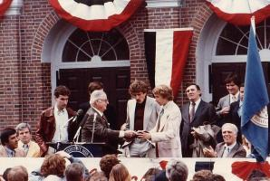 Hodgie wearing said leather coat at Bill Rodgers Day celebration at Faneuil Hall 1979.