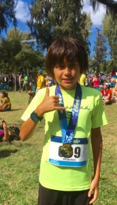 11 year-old Nicholas Pugliese earns applause as Hapalua age-group win.