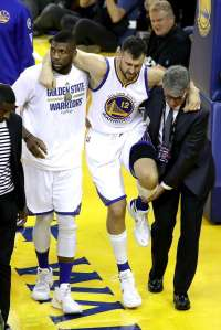Bogut helped off the court after hyperextension
