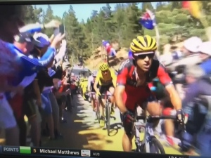 Richie Porte about to slam into TV motorbike