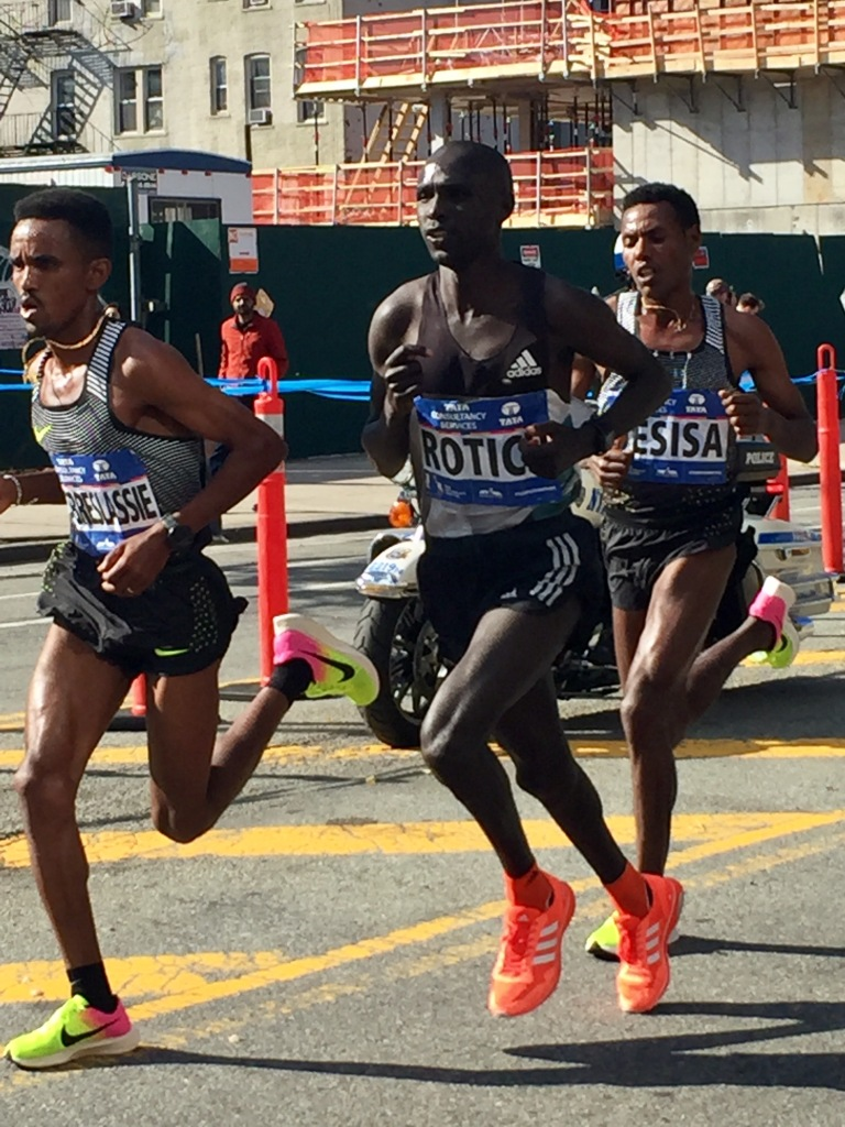 Big three run free. Ghebrslassie, Lucas Rotich & Lelisa Desisa pass halfway in 1:04:25