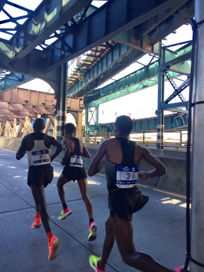 Crossing 59th Street Bridge going from Queens to Manhattan 25K in 1:15:54. 14:48 last 5K
