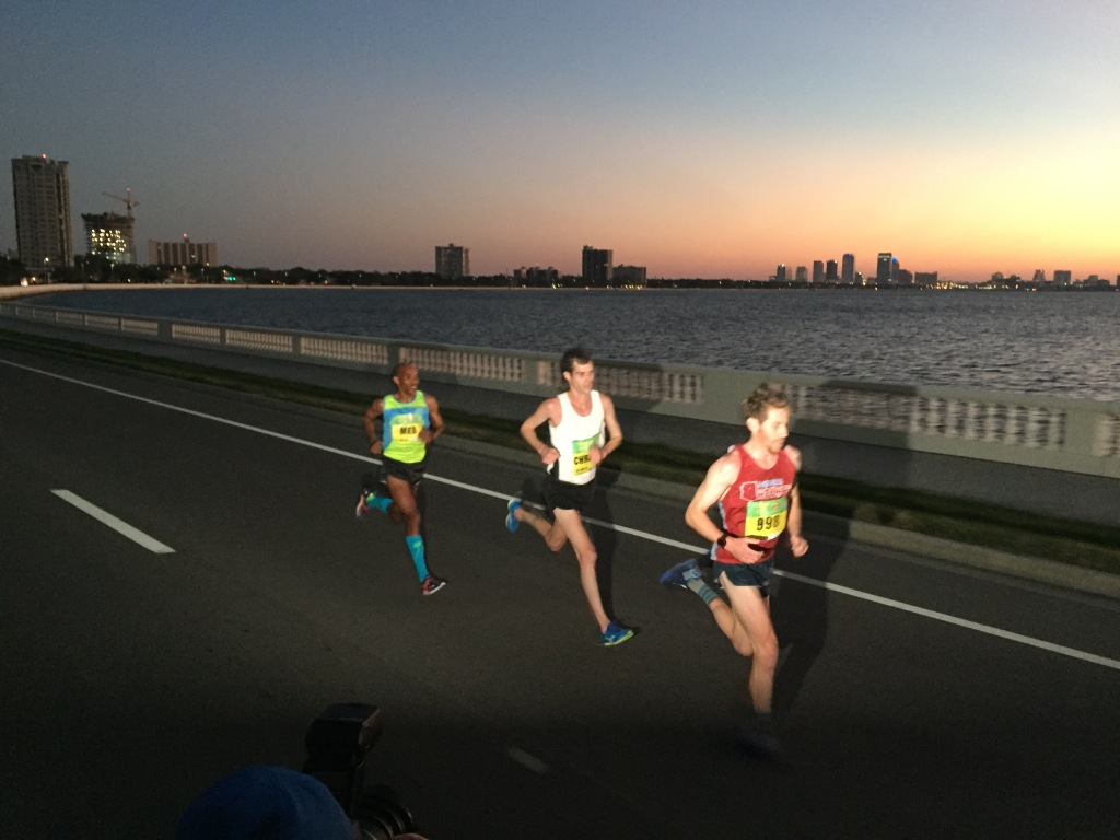 Northern Arizona Elite runner Scott Smith hammering out Bayshore Boulevard near 8 miles. Eventual winner Christo Landry and third-placer Meb Keflezighi hang on tight